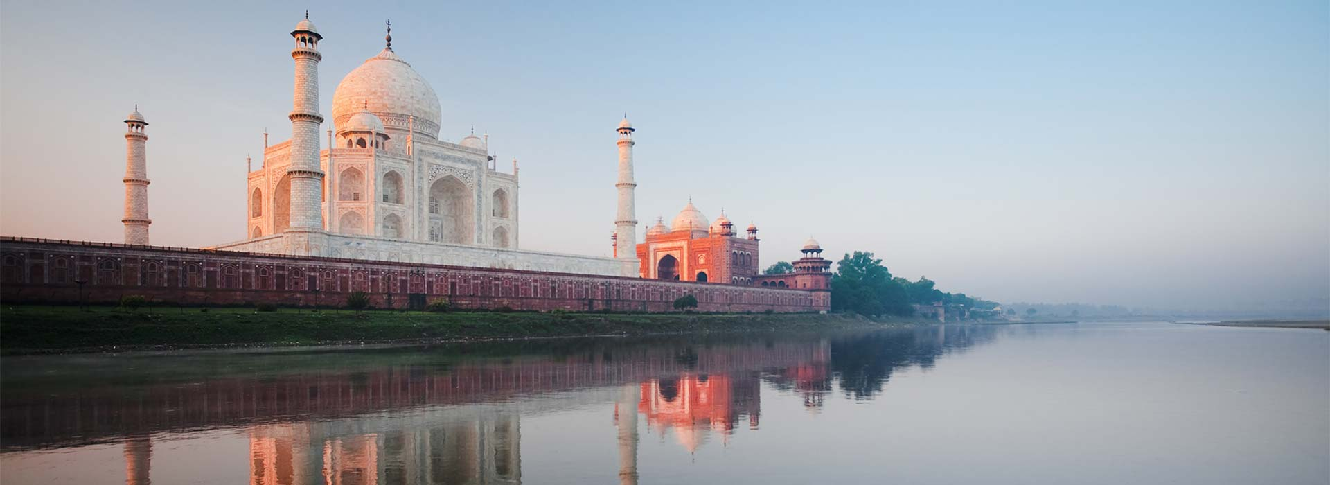 Sunrise at Taj Mahal on Jamuna river.